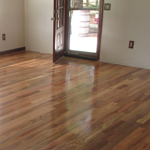 Red Oak character grade prefinished solid wood flooring can be installed on or above grade